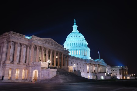 capitol building: Capitol hill building at night illuminated with light, Washington DC.  Stock Photo
