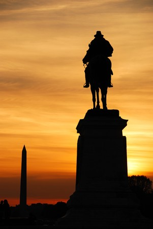 Statue of General Grant of US grant memorial and Washington Monument at sunset, Washington DC. photo
