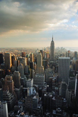 american city: Empire state building, New York City at sunset with manhattan skyline