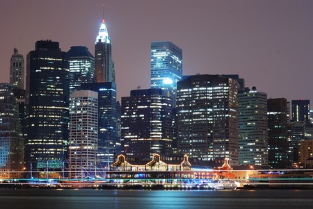 river scape: New York City Manhattan skyline night scene over Hudson River. Stock Photo