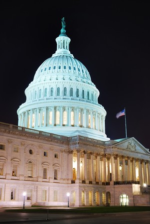 Capitol hill building closeup at night illuminated with light, Washington DC.  photo