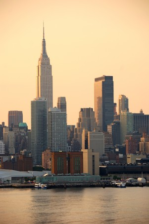 Empire State Building in the morning in Manhattan, New York City over Hudson River photo