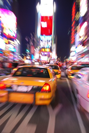 times: New York City Times Square with Yellow Cab and busy traffic.