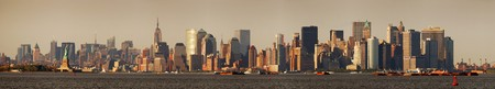 New York City Manhattan skyline panorama with Empire State Building and Statue of Liberty over Hudson River photo