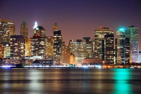 pano: Modern City night scene, New York City Manhattan skyline at night Stock Photo