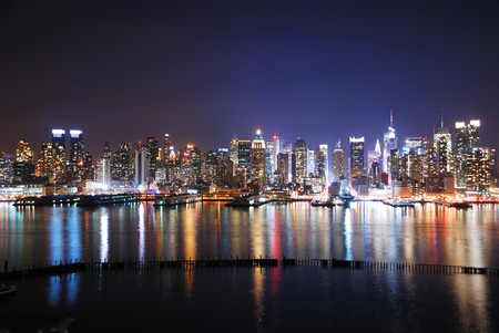 New York City night panorama with Manhattan Skyline over Hudson River with reflection. photo