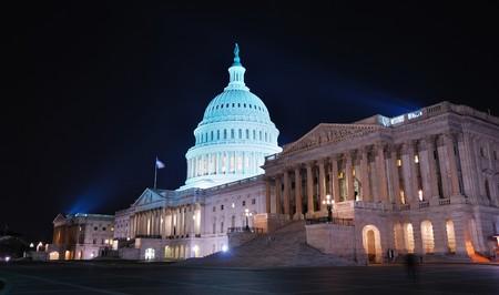 Capitol hill building at night illuminated with light, Washington DC.  photo