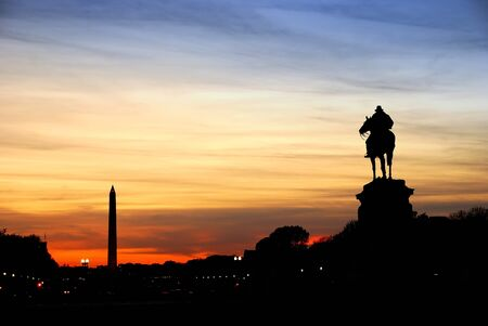 Statue of General Grant silhouette of US grant memorial and Washington Monument at sunset, Washington DC. photo