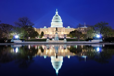 Capitol Hill Building at dusk with lake reflection and blue sky, Washington DC. Stock Photo