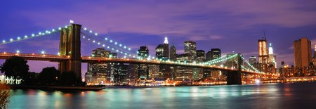 New York City Brooklyn bridge and Manhattan skyline night scene over Hudson River Stock Photo
