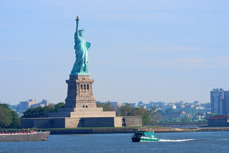 New York City Statue of Liberty with boat in Manhattan over Hudson River photo