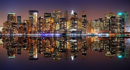 times: Manhattan panorama, New York City Skyline at night with reflection Stock Photo