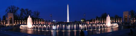 world wars: Washington monument panorama and WWII memorial with fountains and light at dusk, Washington DC. Stock Photo