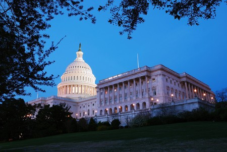 Capitol Hill  building panorama at dusk with light and blue sky, Washington DC. photo