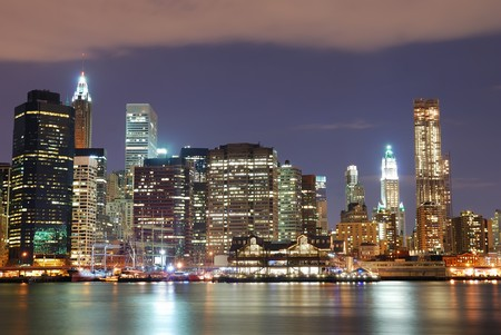 hudson river: New York City Manhattan skyline with office skyscrapers building in at dusk illuminated with lights at night over Hudson River