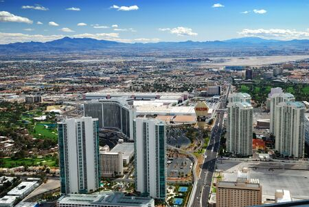 Las Vegas City Skyline Aerial view with mountain and hotels. photo