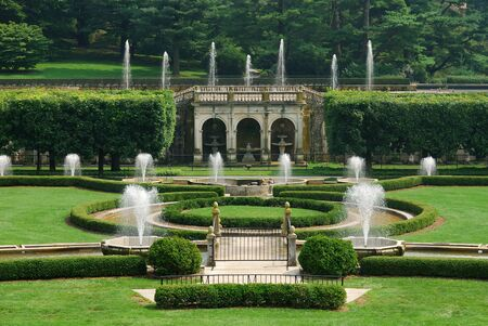 Fountains in garden with green lawn from Longwood Garden, Pennsylvania.  Stock Photo