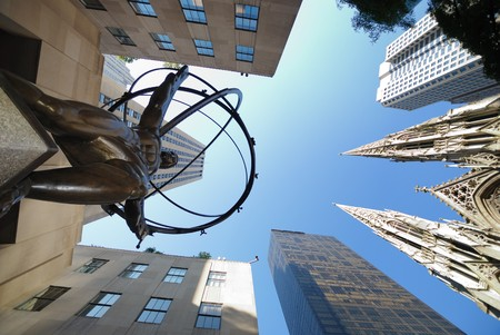 titans: NEW YORK CITY - SEP 5: Fifth Avenue, as a symbol of wealthy New York and one of the most expensive streets in the world, with Atlas statue and St. Patricks Cathedral, September 5, 2009 in Manhattan, New York City.  Stock Photo
