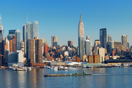 new york city times square: Urban city skyline, Manhattan with Empire State Building, New York City over Hudson River with boat and pier.