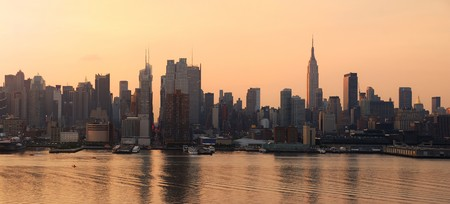 Manhattan skyline panorama in New York City with Empire State Building at sunrise over Hudson River Stock Photo - 7324266