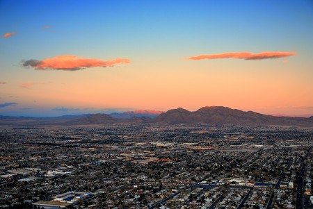 las vegas city: Urban city of Las Vegas aerial view at sunset with mountain. Stock Photo