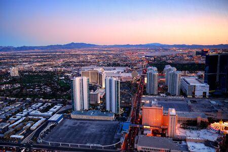 Las Vegas skyline at sunset with hotel illuminated.  photo