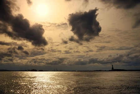 Statue of liberty with sunshine and cloud in New York City photo