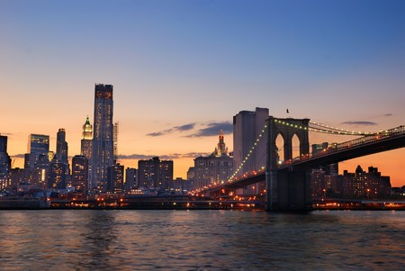 hudson river: New York City Manhattan skyline and Brooklyn Bridge at dusk over Hudson River with skyscrapers