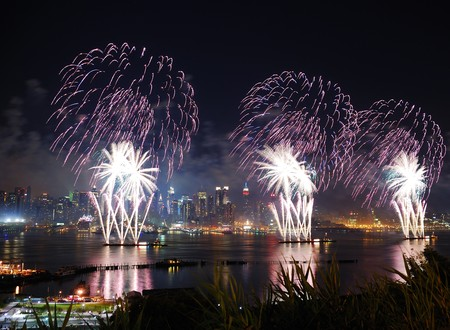New York City Manhattan July 4th Independence day fireworks show with skyline over Hudson River viewed from New Jersey photo