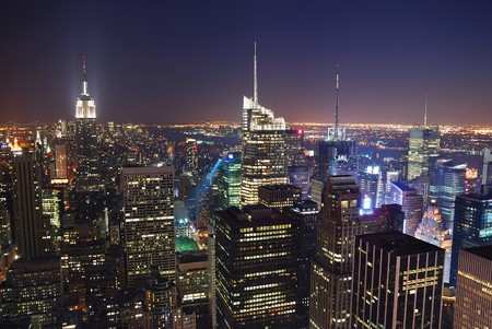 empire: New York City Manhattan skyline night panorama aerial view with Empire State Building and skyscrapers