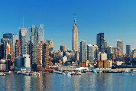 hudson river: Manhattan Skyline with Empire State Building, New York City over Hudson River with boat and pier.