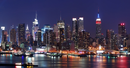 new york: New York City Manhattan skyline panorama at night over Hudson River with refelctions viewed from New Jersey Stock Photo