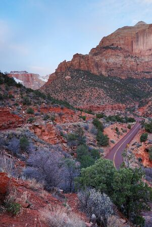 Zion National Park in the morning with red rocks, road and snow in winter, Utah.  photo