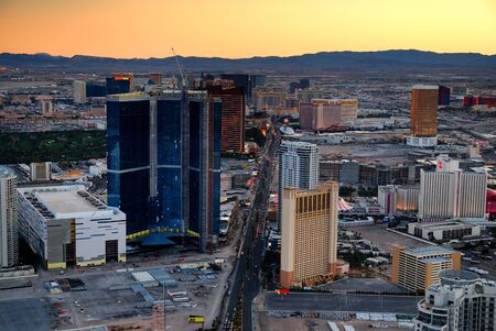 Las Vegas aerial view at sunset with mountain and luxury hotels. photo