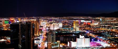 nevada: Las Vegas strip at night. Las Vegas City Skyline panorama with sunset, mountain, luxury hotels and streets.