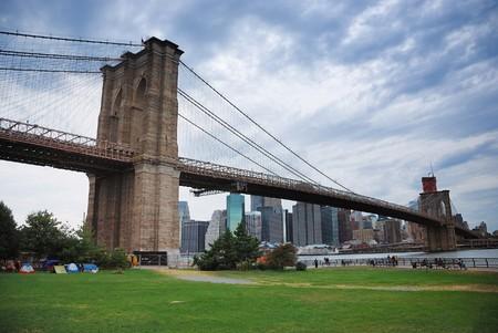 New York City Brooklyn bridge and Manhattan skyline at dusk. photo