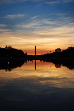Washington monument sunset with lake reflection silhouette panorama, Washington DC photo