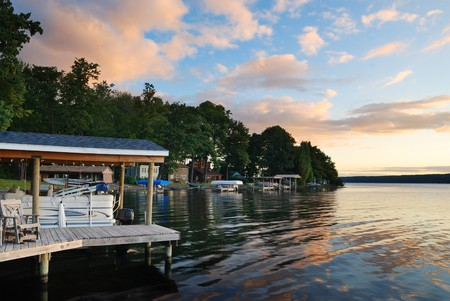 Lake house with pier and woods with sunrise in the morning in New York state Finger Lakes photo