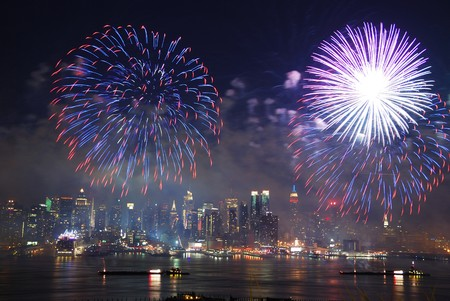 pano: New York City Manhattan July 4th Independence day fireworks show with skyline over Hudson River viewed from New Jersey Stock Photo