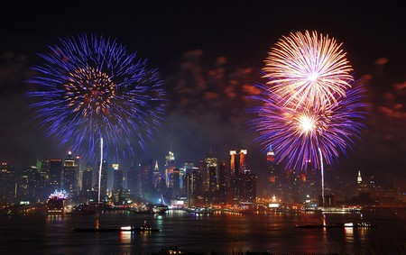 New York City Manhattan July 4th Independence day fireworks show with skyline over Hudson River viewed from New Jersey Stock Photo - 7914732