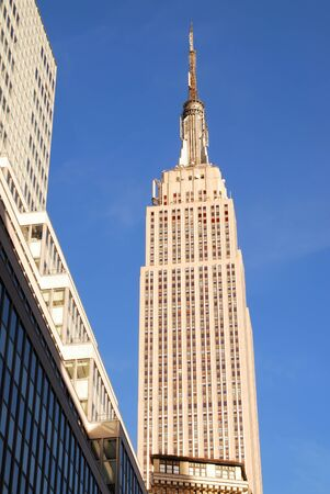 Empire State Building in New York City Manhattan Fifth Avenue with street view and skyscrapers. Stock Photo - 8042348