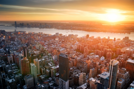 New York City Manhattan sunset skyline aerial view with office building skyscrapers and Hudson River. 스톡 콘텐츠