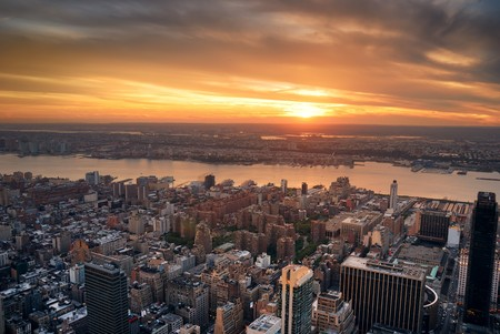hudson: New York City Manhattan sunset skyline aerial view with office building skyscrapers and Hudson River. Stock Photo