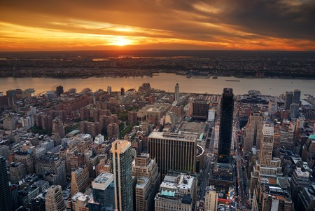 New York City Manhattan sunset skyline aerial view with office building skyscrapers and Hudson River. photo