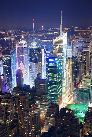 New York City Manhattan Times Square panorama aerial view at night with office building skyscrapers skyline illuminated by Hudson River. Stock Photo