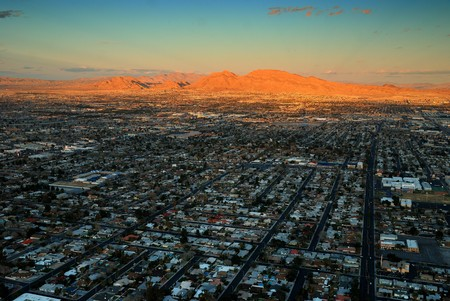 Las Vegas Strip aerial view at sunset with City Skyline with mountain, highway, street and luxury hotels. Stock Photo