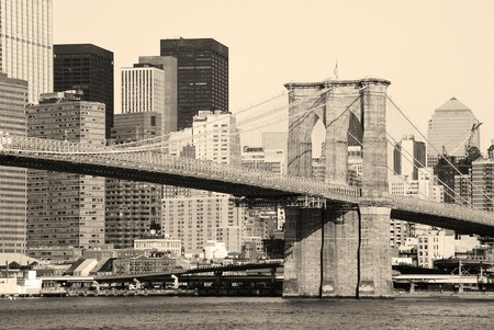 New York City Brooklyn Bridge in Manhattan closeup with skyscrapers and city skyline over Hudson River. photo