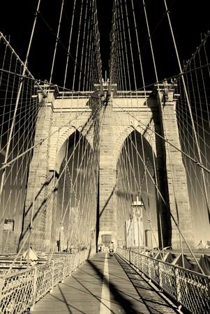 old bridge: New York City Brooklyn Bridge in Manhattan closeup with skyscrapers and city skyline over Hudson River.