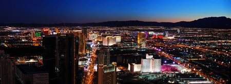 pano: Las Vegas City skyline panorama night view with luxury hotel illuminated. Stock Photo
