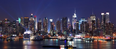 Modern City night scene. New York City Manhattan skyline panorama at night over Hudson River with refelctions viewed from New Jersey Stock Photo